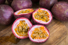 Fresh passion fruits on a wooden background.  royalty free stock images