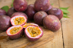 Fresh passion fruits on a wooden background.  royalty free stock photos