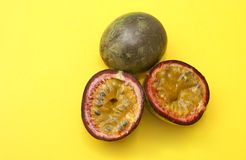 Fresh Passionfruits. Juicy exotic passionfruits on a vibrant yellow contrasting background Stock Images