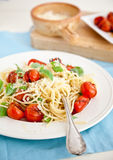 Fresh pasta. Delicious fresh pasta with tomatoes, basil and parmezan Royalty Free Stock Photography