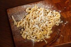Fresh pasta on board Stock Photos