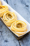 Fresh Pasta. In box on the wooden table Stock Photography