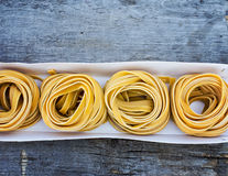 Fresh Pasta. In box on the wooden table Stock Images