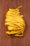 Fresh pasta on brown Stock Photography