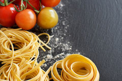 Fresh pasta and cherry tomatoes Royalty Free Stock Images