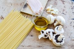 Fresh pasta. Close up of  row  fresh  spaghetti pasta , parmesan cheese,     , olive oil extra vergin,  ham .spaghetti and ingredients. Italian healthy food Royalty Free Stock Photo