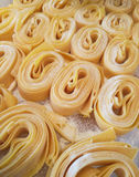 Fresh Pasta and Flour. Process of making fresh homemade pasta in the shop, closeup image Royalty Free Stock Photos