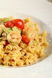 Fresh pasta fusilli with shrimps. And tomatoes Stock Images
