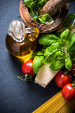 Fresh pasta and herbs, italian cousine. Background Royalty Free Stock Image