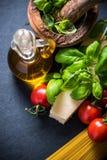Fresh pasta and herbs, italian cousine Royalty Free Stock Image