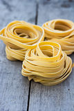 Fresh Pasta. Fresh Homemade Pasta on the wooden table Royalty Free Stock Images