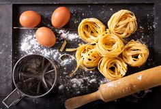 Fresh pasta with ingredients for cooking. Top view Royalty Free Stock Image