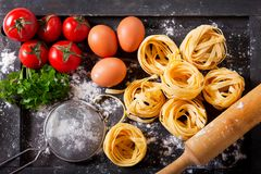 Fresh pasta with ingredients for cooking. Top view Stock Photography