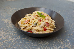 Fresh pasta with mushrooms Stock Photography