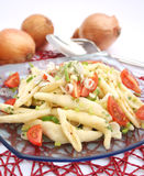 Fresh pasta with onions and tomatoes Royalty Free Stock Photo