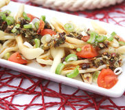 Fresh pasta with onions and tomatoes Stock Photo