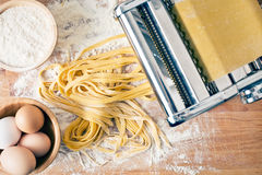 Fresh pasta and pasta machine Royalty Free Stock Images