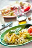 Fresh pasta with pepper sauce Stock Photo