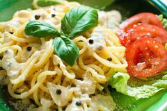 Fresh pasta with pepper sauce and salad Stock Image