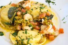 Fresh pasta ravioli filled seafood. Fresh pasta ravioli filled with potatoes and seafood stock photography