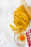 Fresh pasta and raw egg Royalty Free Stock Image