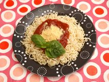 Fresh pasta with a sauce of tomatoes Royalty Free Stock Photo