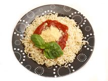 Fresh pasta with a sauce of tomatoes Stock Photo