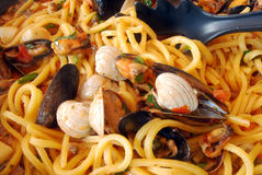 Fresh pasta with seafood Stock Images