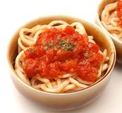 Fresh pasta. Some fresh pasta with a sauce of tomatoes Stock Image