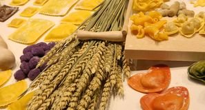 Fresh pasta in a specialized Italian food store and ears of whea. Fresh pasta in a specialized Italian food store and ears of ripe wheat Royalty Free Stock Photo