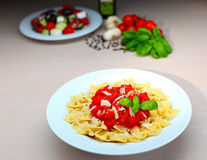 Fresh pasta with tomato sauce Stock Photos
