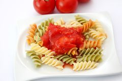 Fresh pasta with tomato sauce Stock Images