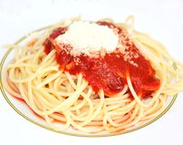 Fresh pasta with tomato-sauce. Some fresh spaghettis with tomato-sauce and parmesan cheese royalty free stock photography
