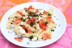 Fresh pasta with tomatoes and cheese Stock Photos