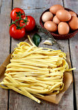 Fresh pasta with tomatoes and eggs Royalty Free Stock Images