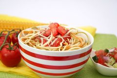 Fresh pasta with tomatoes Stock Images