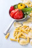 Fresh pasta and vegetables Stock Photos