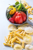 Fresh pasta and vegetables Royalty Free Stock Photos