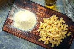 Fresh pasta on a wooden Board with flour. Fresh home made pasta on a wooden Board with flour. Top view with copy space stock photography