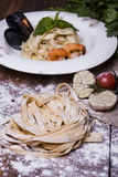 Fresh pasta on the wooden table royalty free stock photo