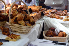 Fresh pastries at the bakery counter trading Royalty Free Stock Photos