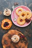Fresh pastries ,cupcakes , eclairs, scones with raspberry jam. The view from the top. royalty free stock image