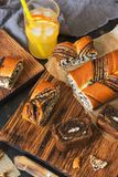 Fresh pastries with poppy seeds. A sweet roll and orange juice. stock photos