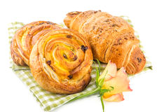 Fresh pastry and croissant isolated over white background Royalty Free Stock Image