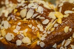 Fresh pastry crunch with maple syru. P sprinkled with sliced almonds Stock Photography