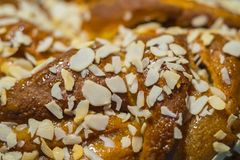 Fresh pastry crunch with maple syru. P sprinkled with sliced almonds Royalty Free Stock Image