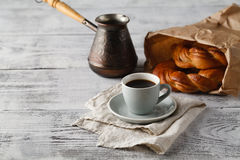 Fresh pastry and cup of coffee Royalty Free Stock Photo