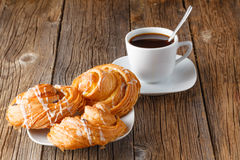 Fresh pastry rolls and coffee cup Royalty Free Stock Image