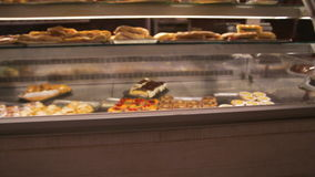 Fresh pastry in the shop window stock footage