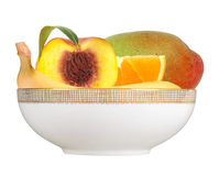 Fresh peach; banana, orange and mango fruits in plate isolated o Royalty Free Stock Photos